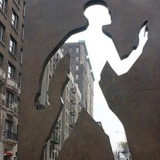 """The Invisible Man"" sculpture stands in front of the longtime home of acclaimed author Ralph Ellison in New York's West Harlem."