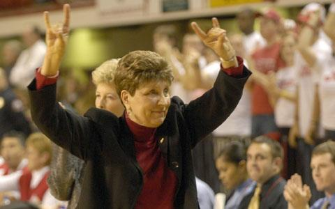 North Carolina State coach Kay Yow responds to the crowd with a Wolfpack salute