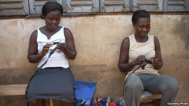Janet and Mercy, two of the KamiAmi Women, practice their crocheting skills. (Photo by Jackie Abrams)